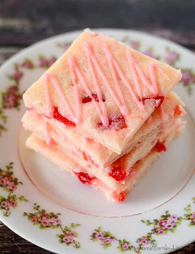 sugar cookie bars with maraschino cherries and glaze