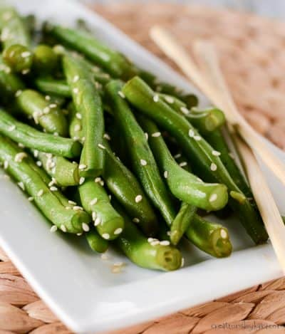 fresh cooked easy green beans on a plate with chopsticks