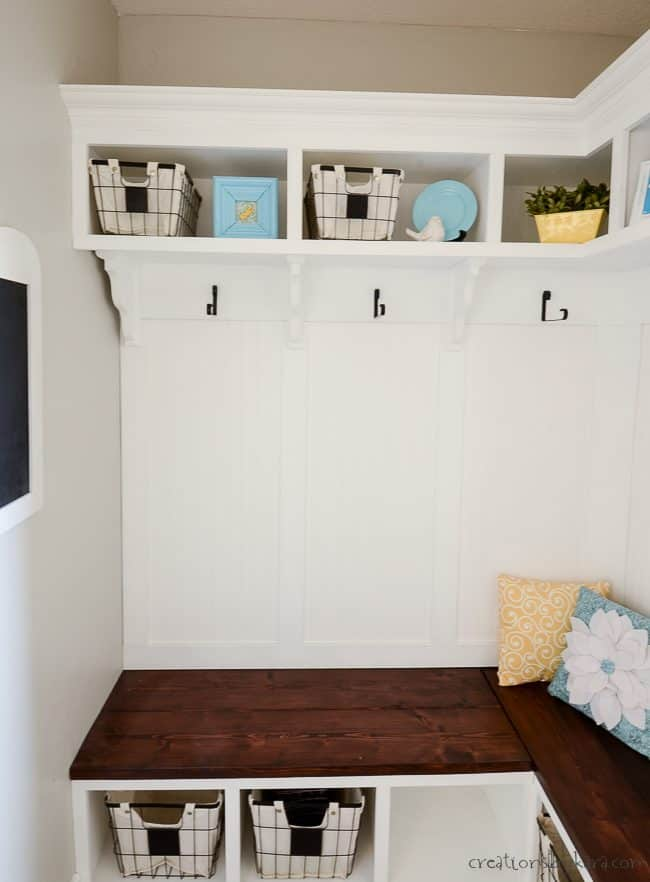 DIY trim and shelves above a mudroom bench