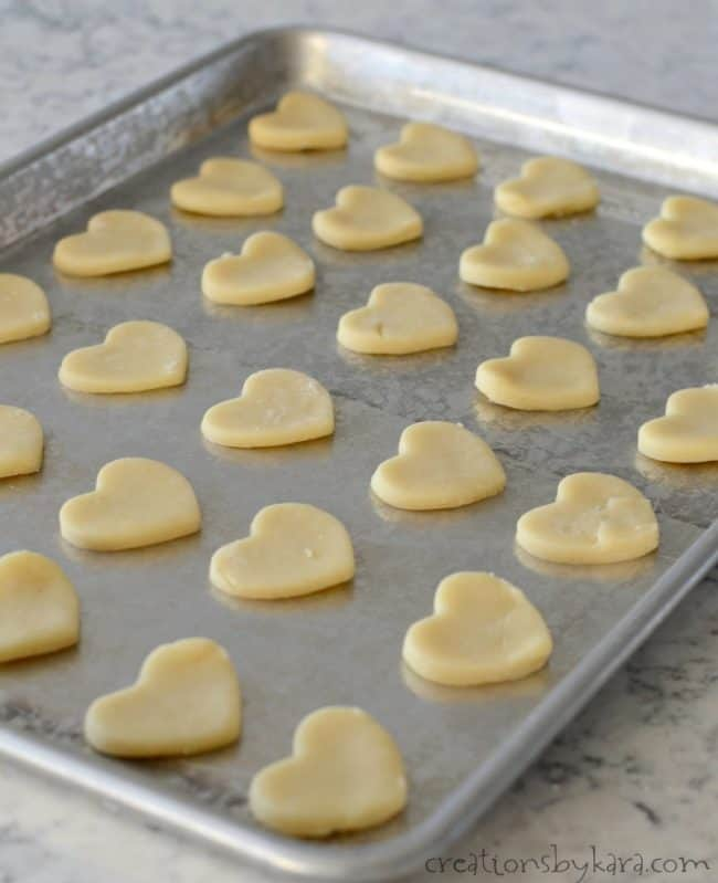 shortbread hearts on a cookie sheet before baking