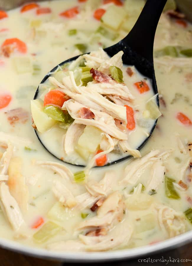 ladle of creamy chicken soup