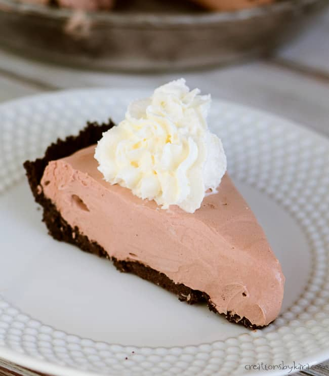 slice of creamy chocolate pie on a white plate