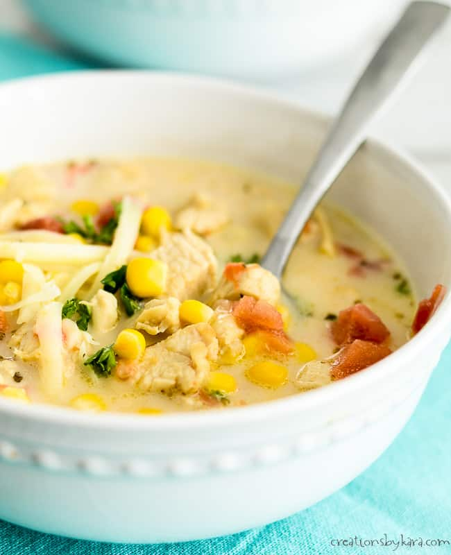 mexican chicken corn soup in a bowl with a spoon