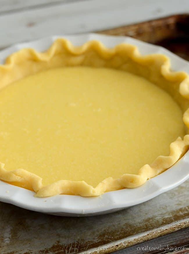 filling in an unbaked pie shell