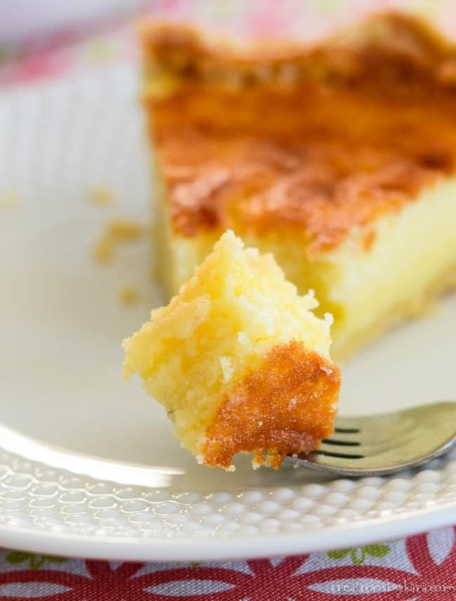 forkful of buttermilk pie with a slice in the background