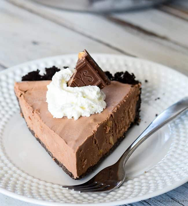 slice of easy chocolate pie topped with whipped cream and chocolate
