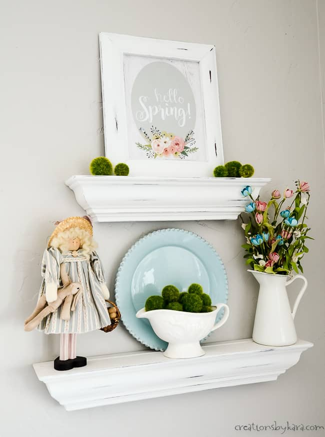 shelf with hello spring sign