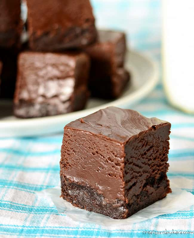 piece of nutella fudge brownie with a plate of brownies in the background