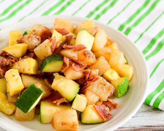 plate of bacon potato zucchini dinner
