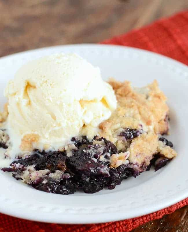 This Blueberry Dump Cake uses fresh berries instead of blueberry pie filling, so it has a fresh taste that is unbeatable! #blueberrydumpcake #blueberrycrisp #creationsbykara