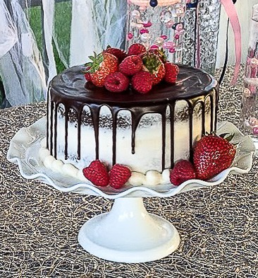 gluten free chocolate wedding cake with chocolate ganache and strawberries