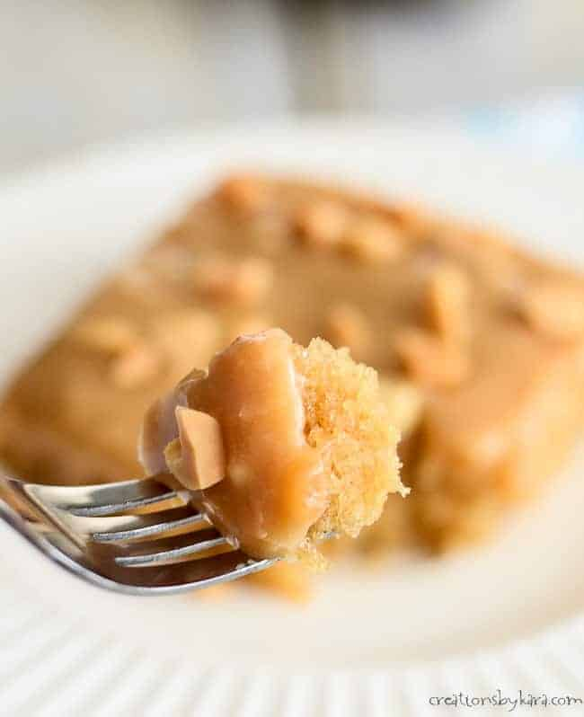 Peanut Butter Sheet Cake - tender and moist peanut butter cake made in a jelly roll pan and topped with peanut butter frosting. A perfect dessert for the peanut butter lover!