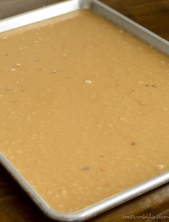 Peanut butter cake batter in a sheet pan