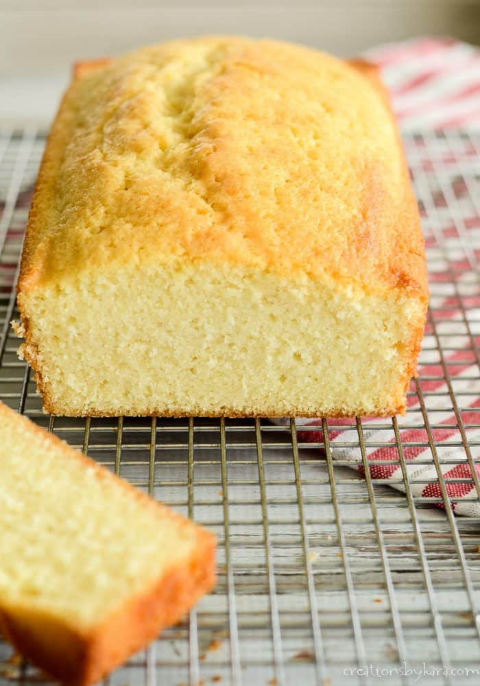Cut loaf of the best pound cake on a cooling rack