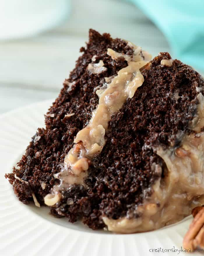 slice of chocolate cake with coconut pecan frosting
