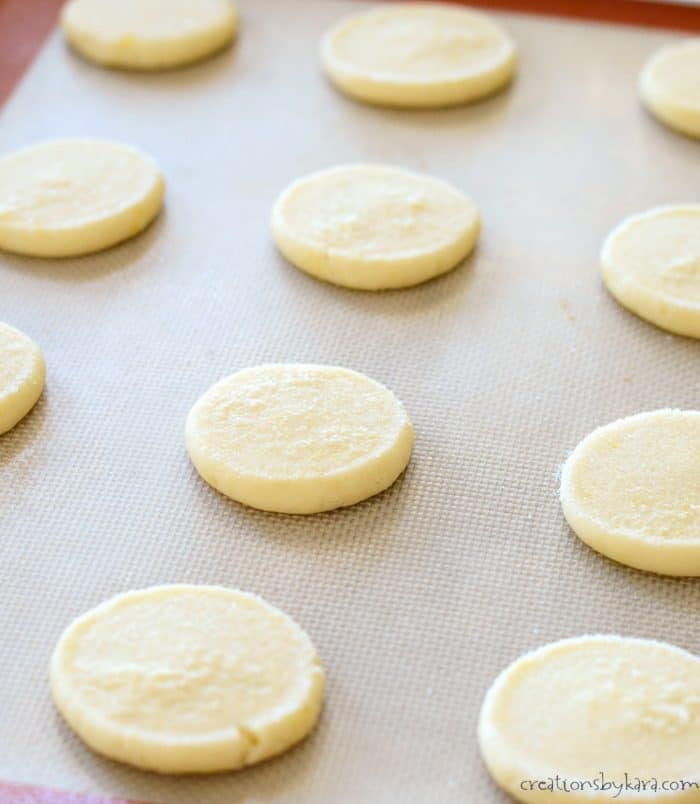 flattened lemon cookie dough on a cookie sheet