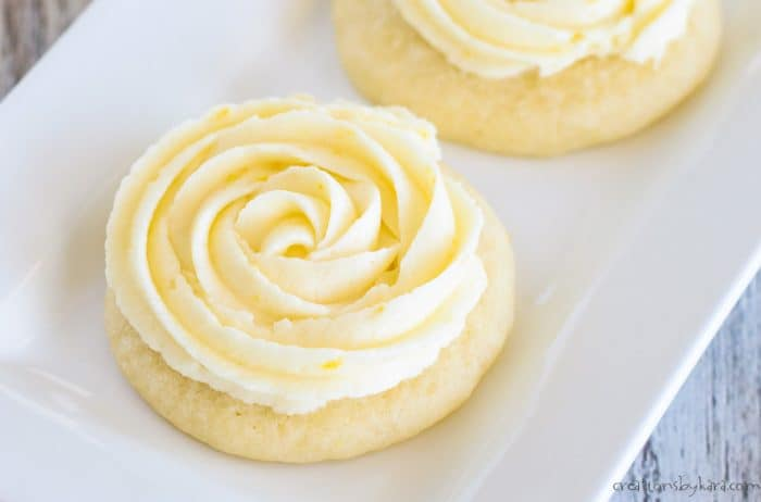 close up of lemon frosting on a sugar cookie
