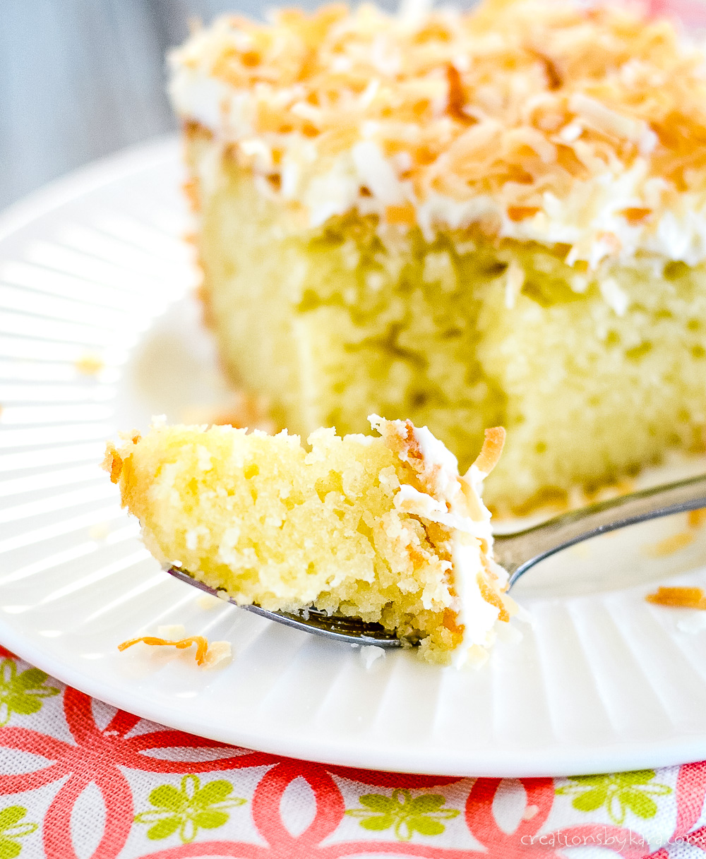 bite of coconut cake on a fork