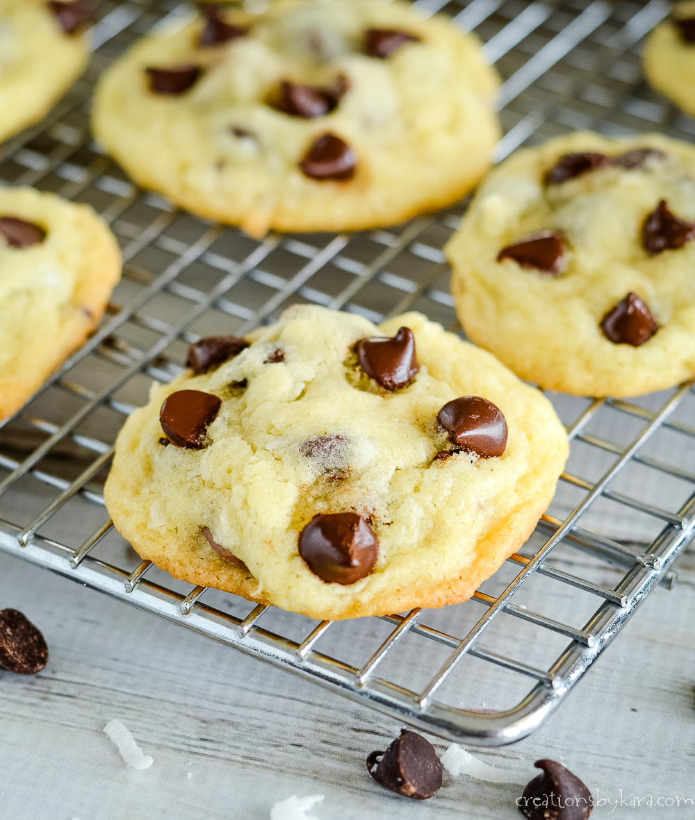 chocolate chip cookies with shredded coconut on a cooling rack