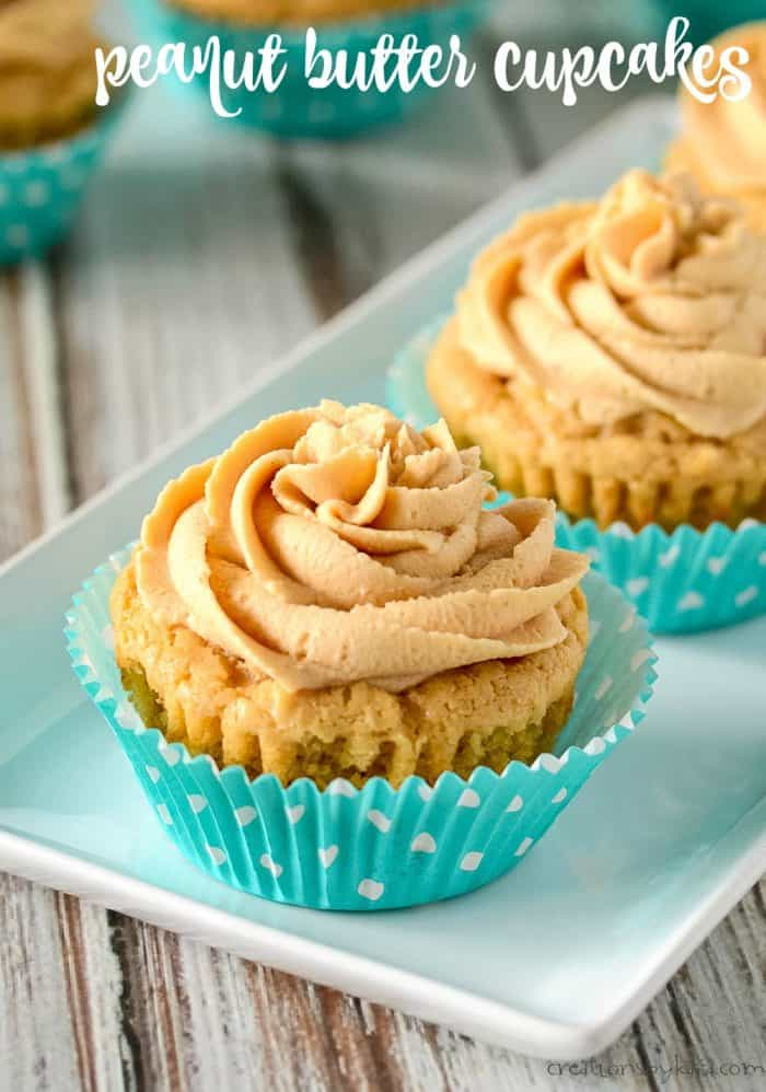 peanut butter cupcakes with peanut butter frosting on a white tray