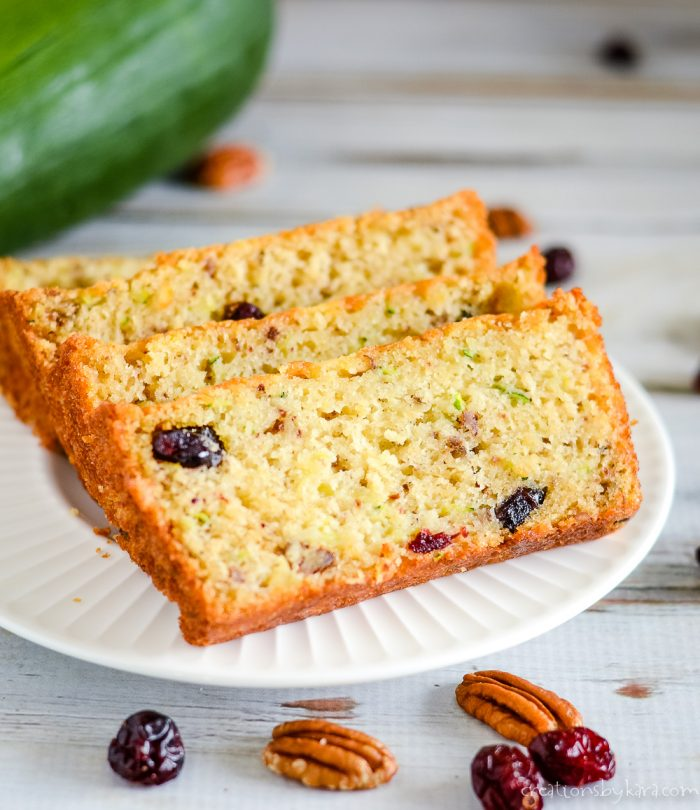 slices of pineapple cranberry zucchini bread on a plate