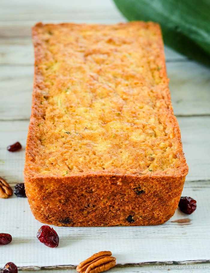 loaf of pineapple zucchini bread with craisins