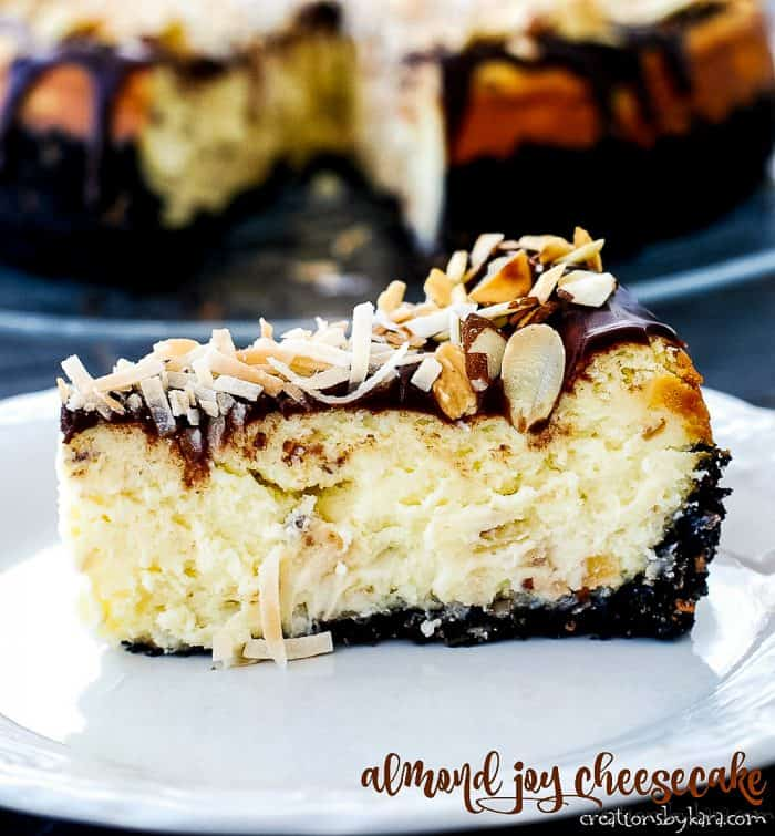 slice of almond joy cheesecake on a plate