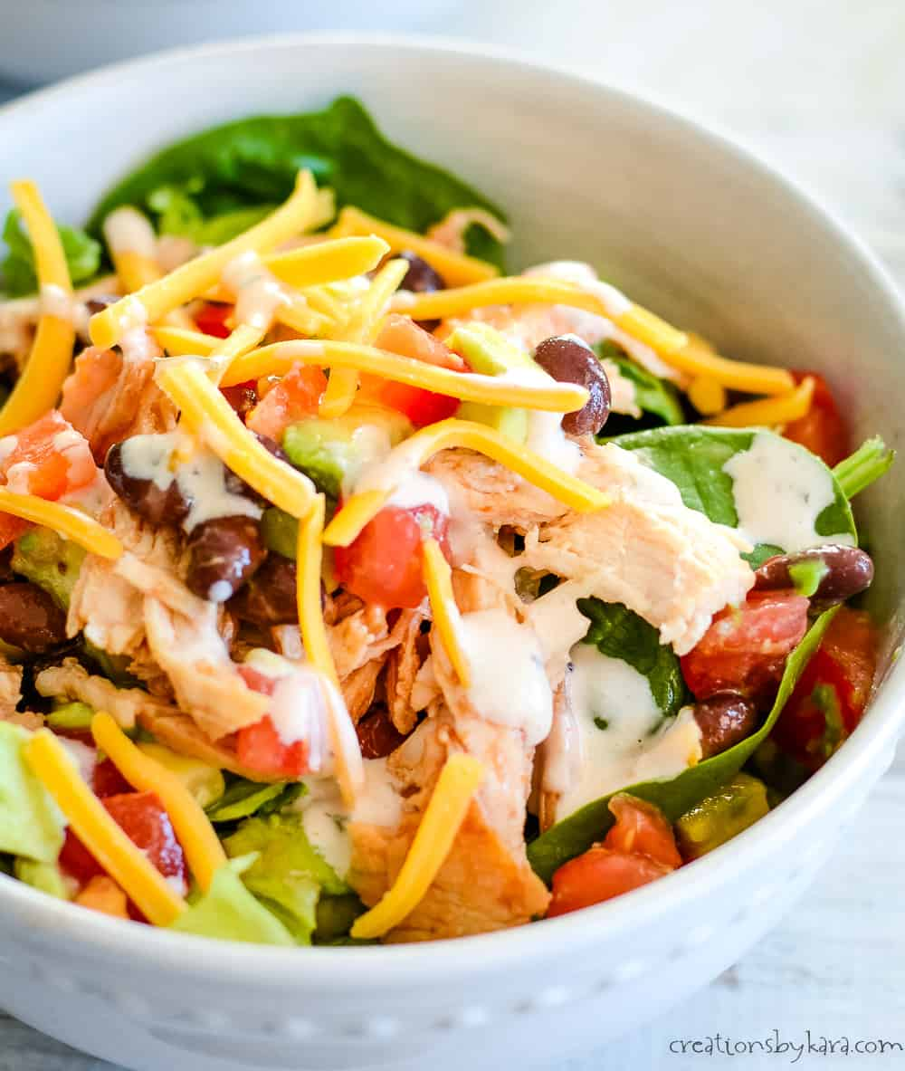 close up of salad with chicken and bbq ranch dressing