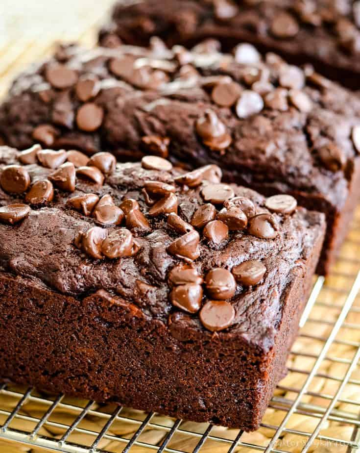 Double Chocolate Banana Bread . . . with both cocoa and chocolate chips, this banana bread is a chocolate lover's dream! Every bite is decadent. #doublechocolatebananabread #chocolatebananabread #creationsbykara
