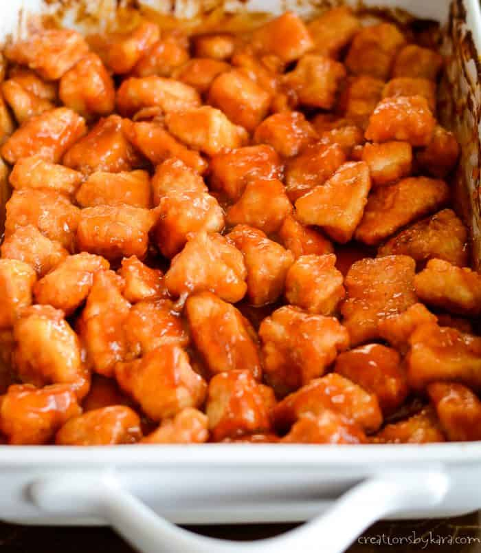 pan of chicken chunks covered in sweet and sour sauce