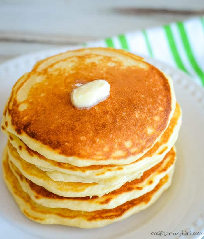 stack of homemade pancakes with melting butter