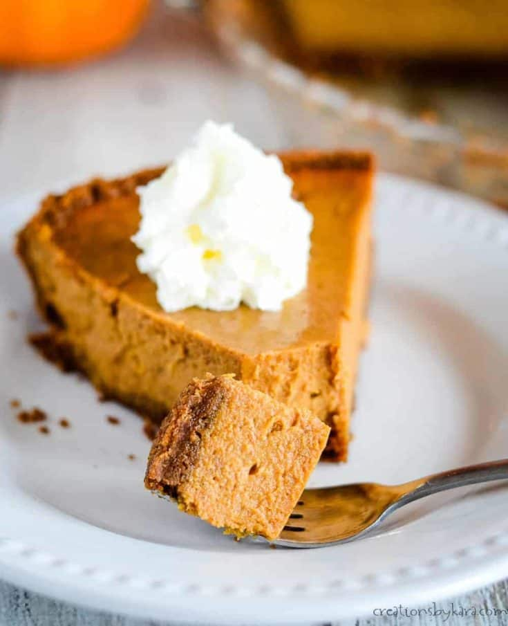 Pumpkin Pie with sweetened condensed milk is incredibly easy to make and tastes fantastic. A biscoff crumb crust sets it apart from traditional pumpkin pie. #sweetenedcondensedpumpkinpie #easypumpkinpie #creationsbykara