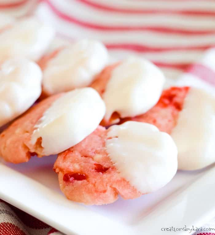 close up of cherry cookies dipped in white chocolate