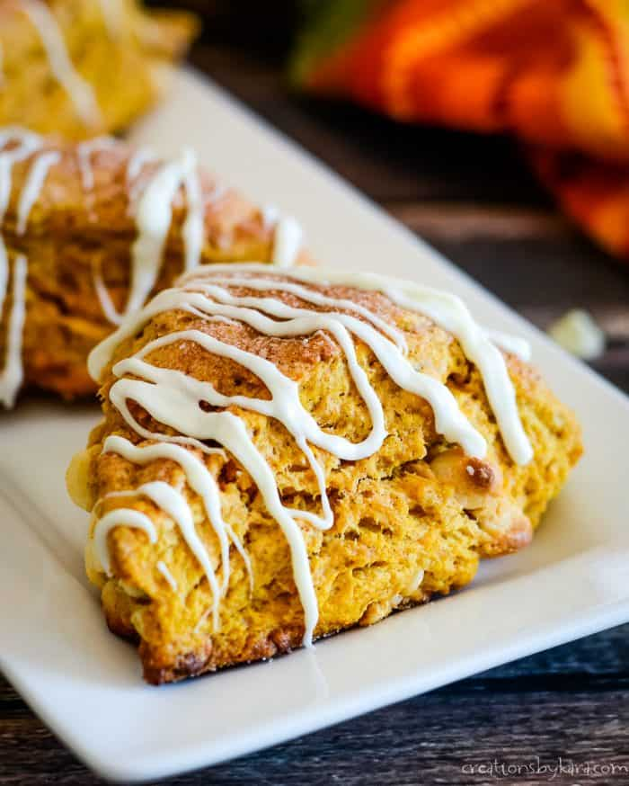 close up of pumpkin scone drizzled with white chocolate