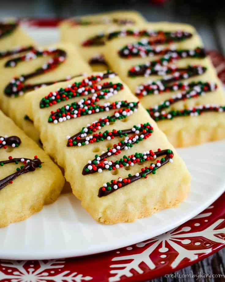 plate of shortbread cookies drizzled with chocolate