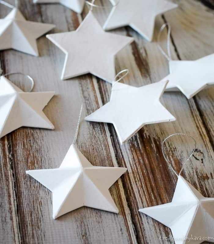 white painted paper mache star ornaments