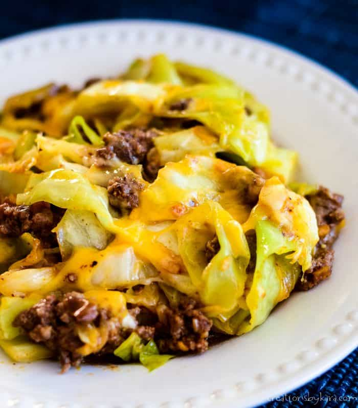close up of taco ground beef and cabbage with melted cheese on a plate