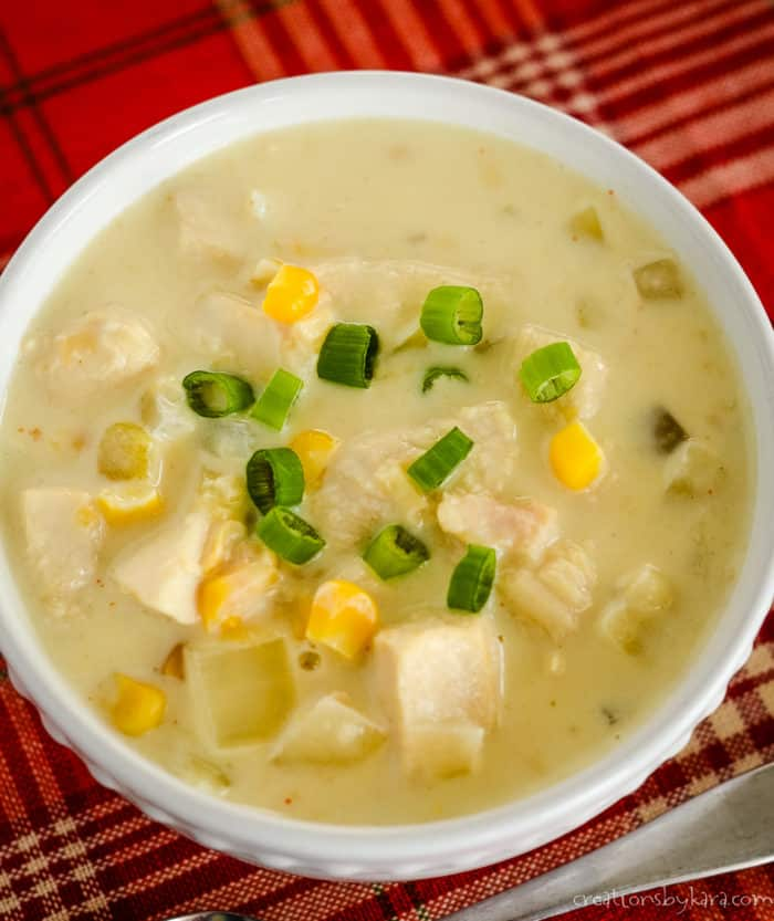 overhead shot of spicy corn chowder with chicken and green onions