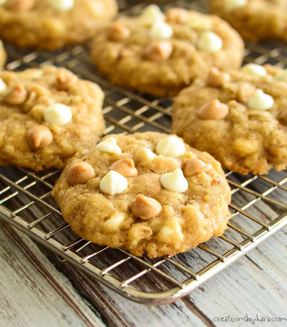 peanut butter cookies with oats and white chocolate on a cooling rack