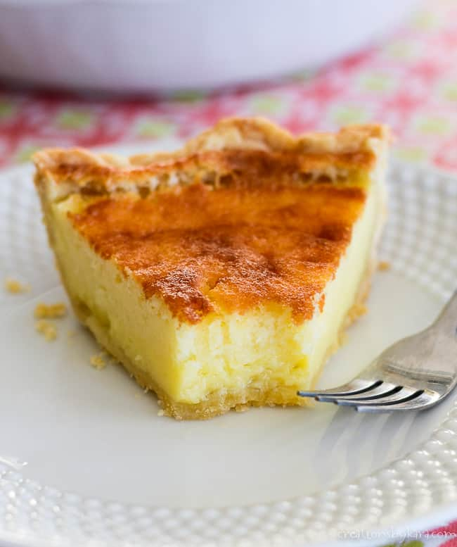 slice of buttermilk pie on a plate with a fork
