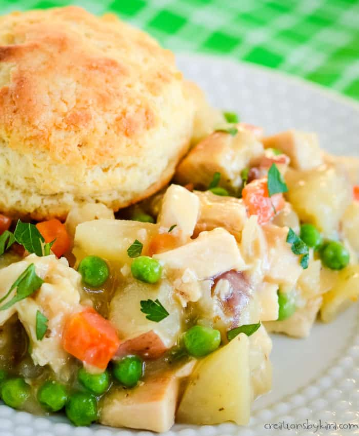close up of chicken pot pie topped with a biscuit