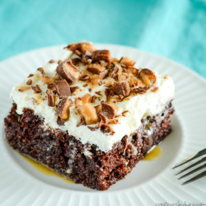 slice of chocolate cake with caramel, Heath, and whipped cream