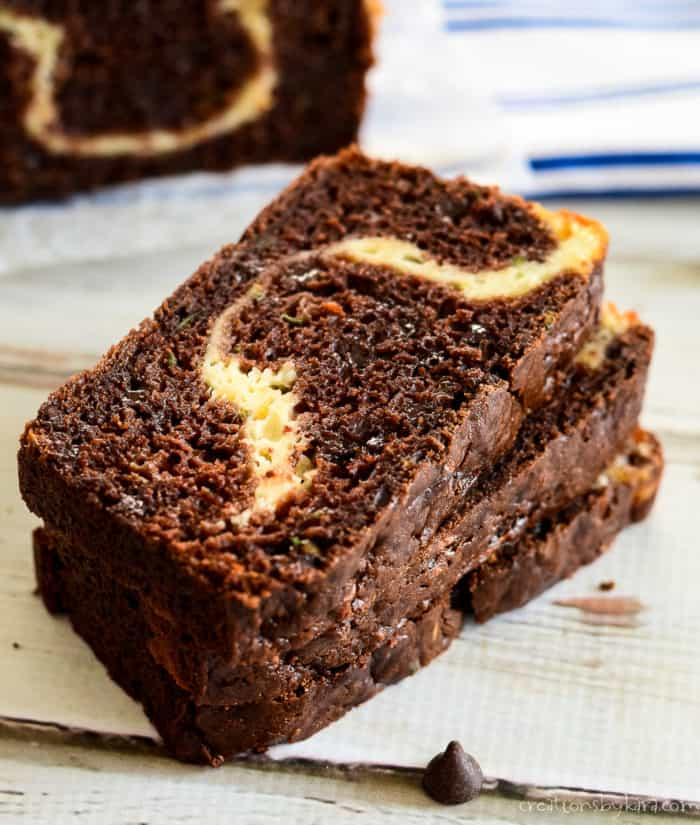 stack of sliced cream cheese filled chocolate zucchini bread