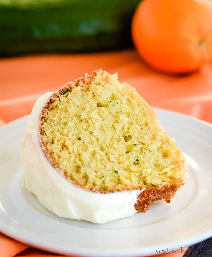 slice of orange zucchini cake on a plate