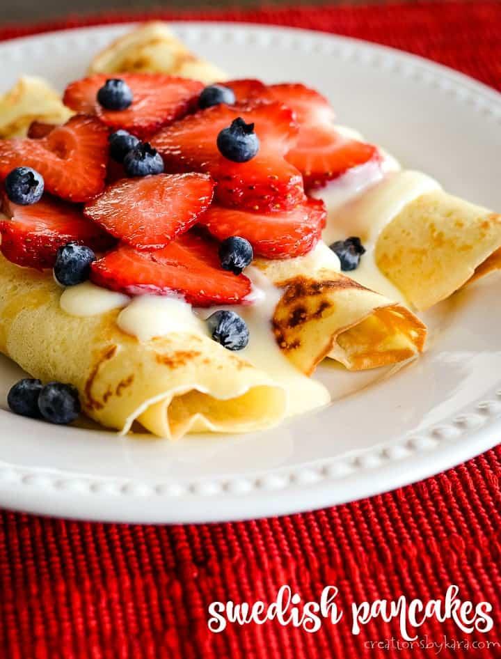 swedish pancakes with vanilla sauce and berries