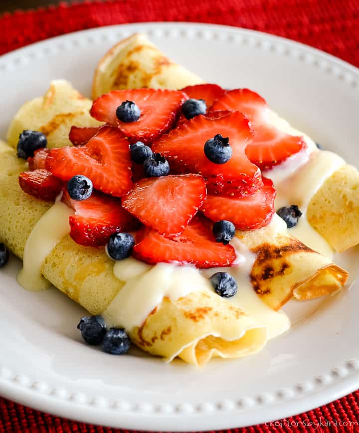 plate of swedish pancakes with berries