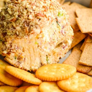 close up of inside of a bacon cheese ball surrounded with crackers