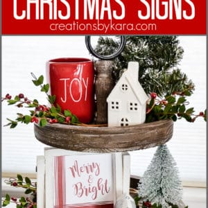 merry and bright christmas sign on a tiered tray