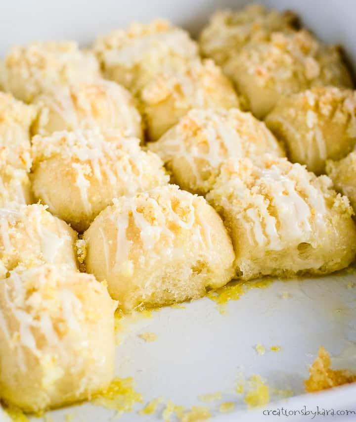pan of lemon sweet rolls with glaze