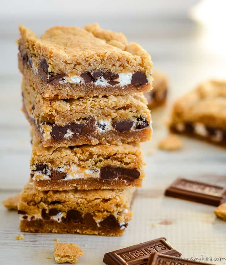stack of s'mores bars with hershey bars in the foreground